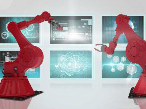 Two red bin picking robots in front of screens