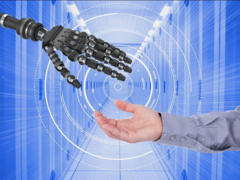 An industrial automation concept showing a human and a robotic hand
