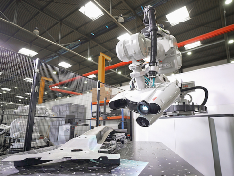 An ABB 3D robotic inspection cell working in a factory