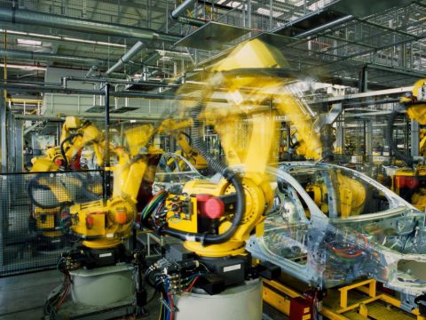 Fast moving robots working in an automotive assembly line