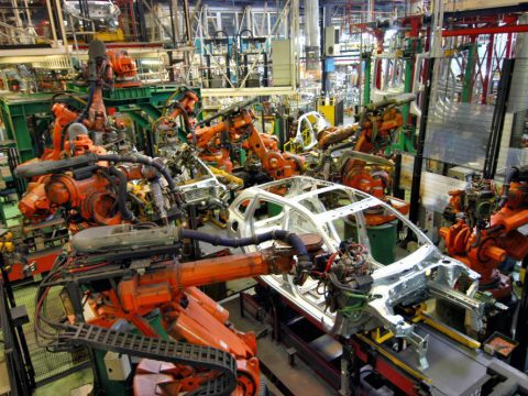 Various robots assembling a car's structure