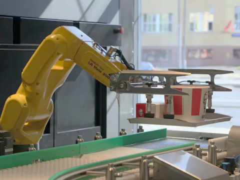 A robotic arm preparing fast food at a KFC franchise
