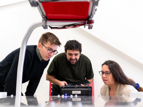 Engineers using a robot programming software