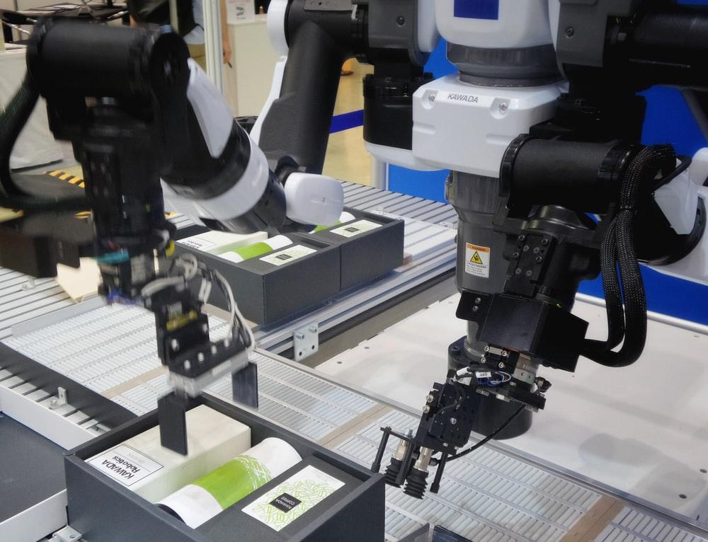 Two industrial robot arms